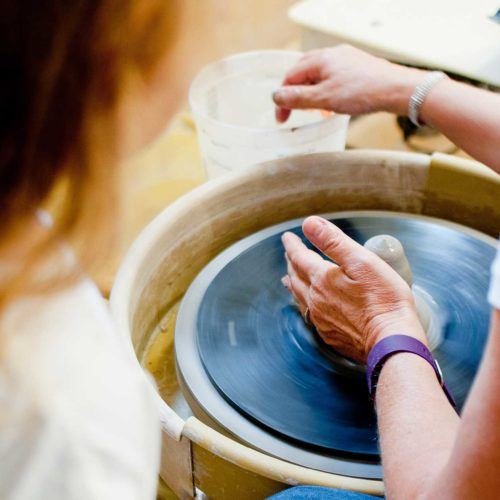 potter using a pottery wheel