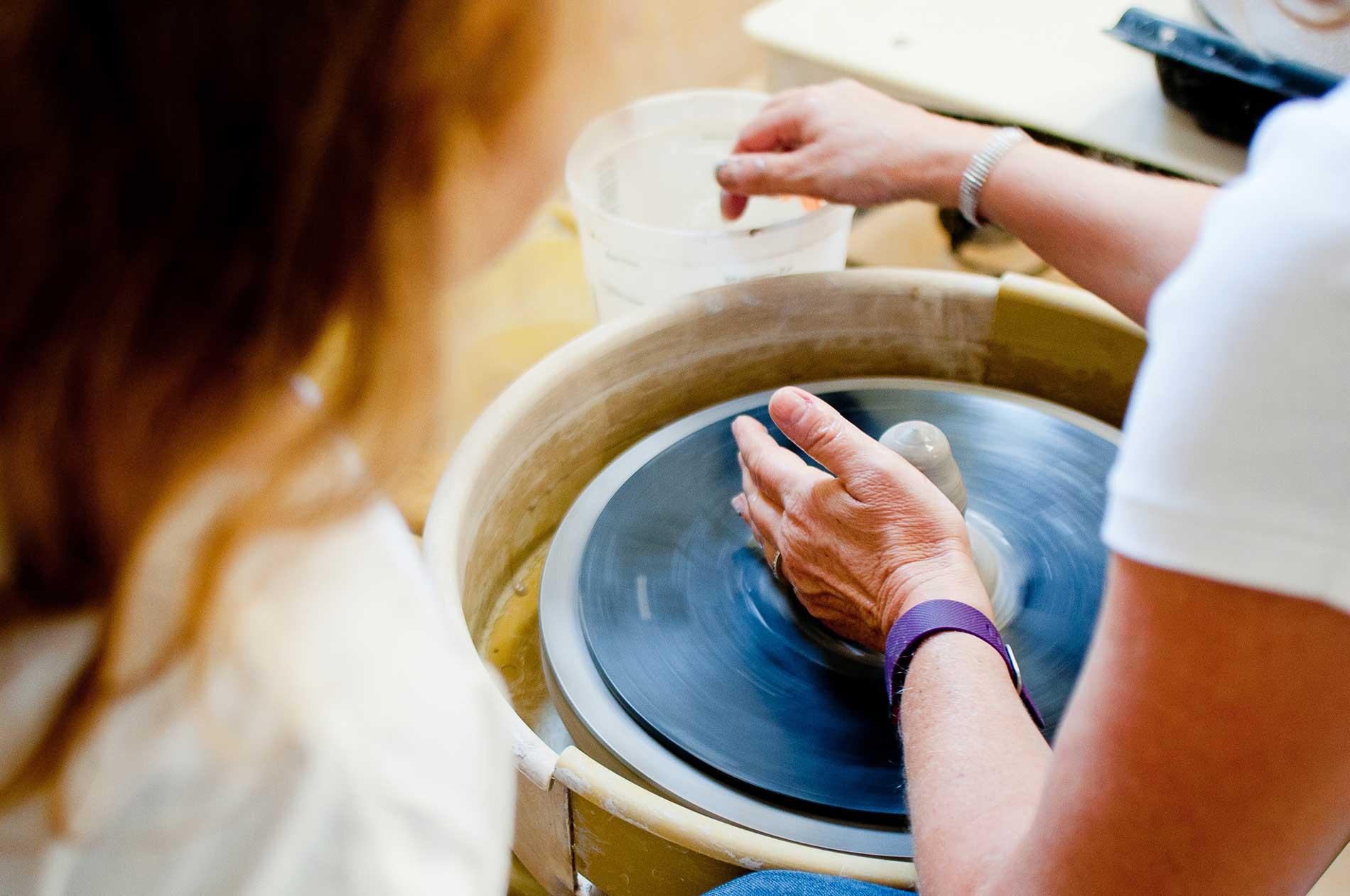 potter using a pottery wheel
